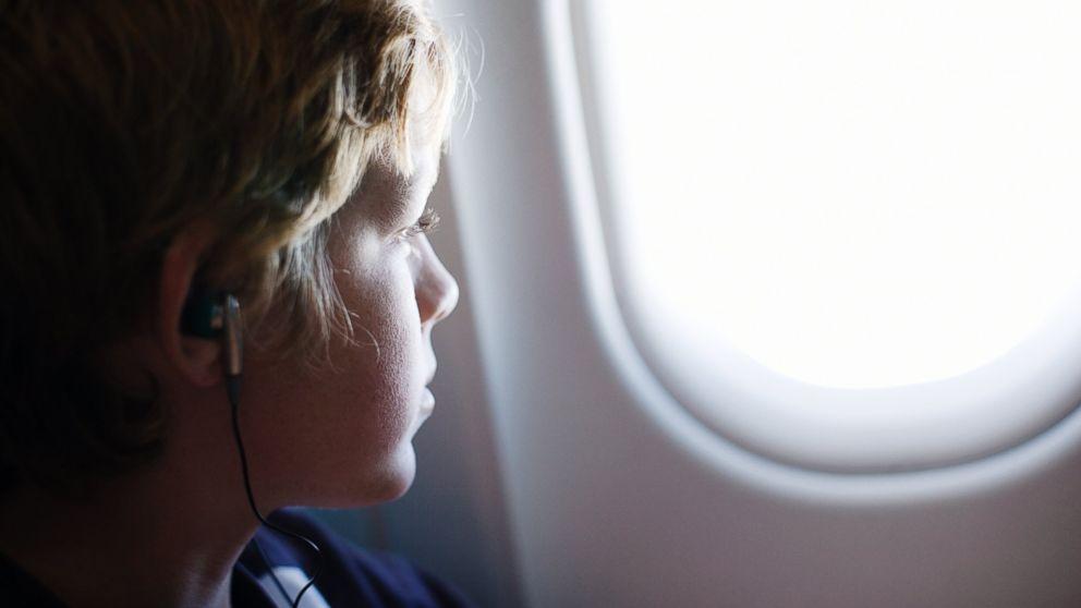 GTY_child_alone_airplane_jef_131011_16x9_992