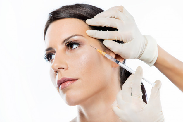 beautiful-young-woman-getting-botox-cosmetic-injection-her-face_1301-7520